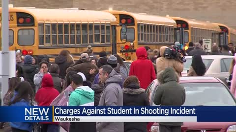Charges filed against student who pointed gun at officers inside...